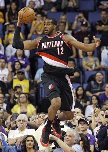 Portland Trail Blazers' LaMarcus Aldridge leaps to pass in the second half of their preseason NBA basketball game against the Los Angeles Lakers in Ontario, Calif., Wednesday, Oct. 10, 2012. Aldridge was high scorer with 14 points as Portland won 93-75. (AP Photo/Reed Saxon)