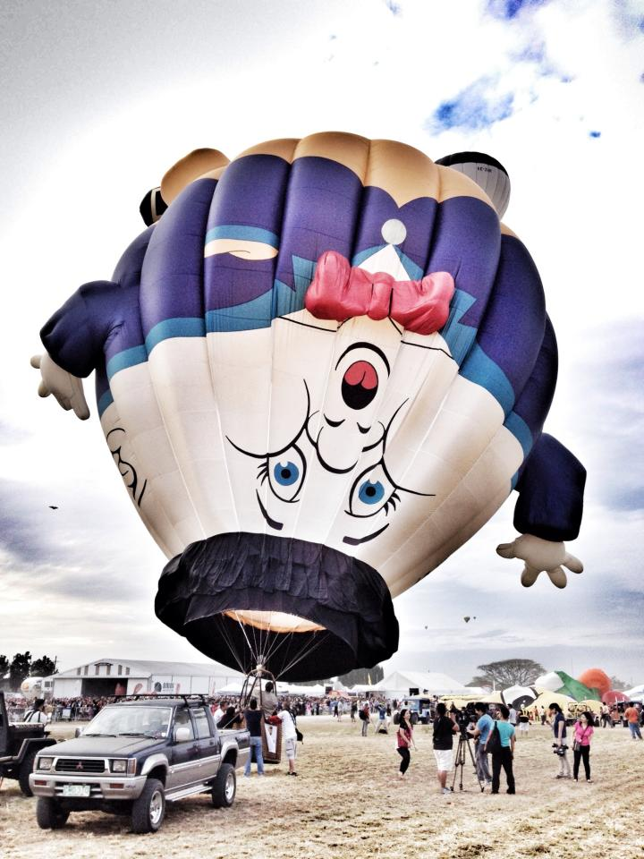 FLYING: MORE FUN IN THE PHILIPPINES. At least 26 balloons are flown during the opening of 18 Philippine International Hot Air Balloon Fiesta at Clark Field, Pampanga, Feb. 21, 2013. (Photo courtesy of Rolan Garcia)