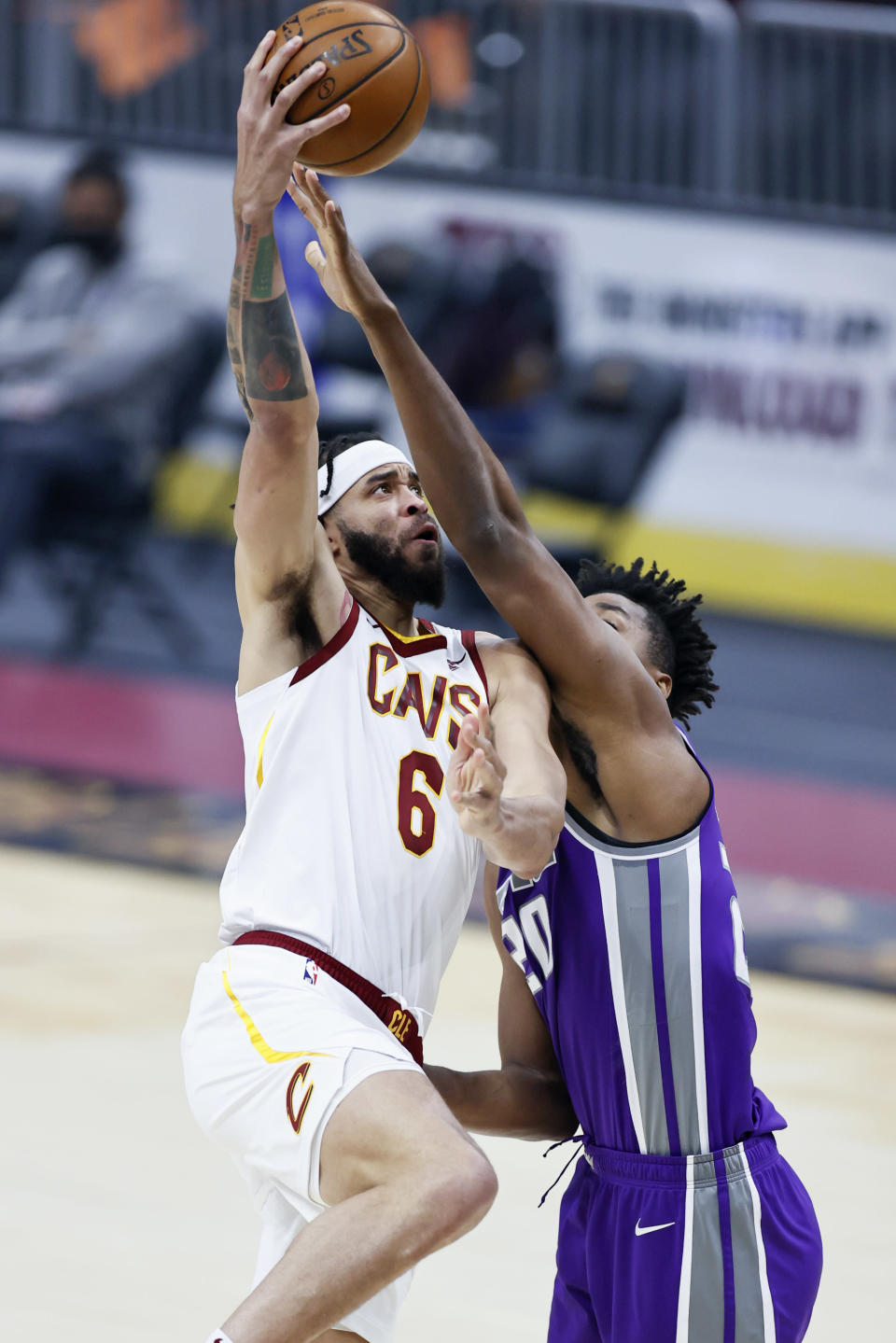 Cleveland Cavaliers' JaVale McGee (6) shoots against Sacramento Kings' Hassan Whiteside (20) in the first half of an NBA basketball game, Monday, March 22, 2021, in Cleveland. (AP Photo/Ron Schwane)