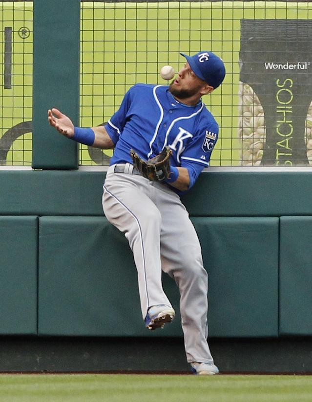 Kansas City Royals left fielder Alex Gordon bobbles a ball hit by Los Angeles Angels' Albert Pujols in the fifth inning of a baseball game Saturday, May 24, 2014, in Anaheim, Calif. After video review, it was ruled a double, and is the 2,400th hit of Pujols' career. (AP Photo/Alex Gallardo)