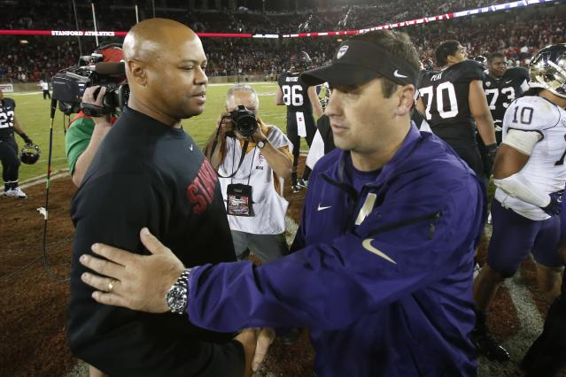 STANFORD, CA - OCTOBER 5: Head Coach David Shaw (L) of the Stanford Cardinal speaks with head coach Steve Sarkisian of the Washington Huskies after their game on October 5, 2013 at Stanford Stadium in Stanford, California. The Cardinal defeated the Huskies 31-28.(Photo by Stephen Lam/Getty Images)