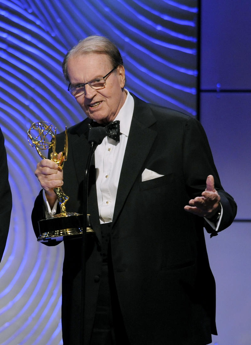 "FILE - In this June 16, 2013 file photo, Charles Osgood accepts the award for outstanding morning program for ""CBS Sunday Morning"" at the 40th Annual Daytime Emmy Awards in Beverly Hills, Calif.  CBS says it will donate the bow tie that Osgood wears Sunday to host his final edition of ""Sunday Morning"" to the Smithsonian's National Museum of American History. The 83-year-old newsman is stepping down, Sunday, Sept. 25, 2016,  after 22 years as anchor of the leisurely-paced ""Sunday Morning,"" which usually dominates the news ratings on that day.(Photo by Chris Pizzello/Invision/AP)"