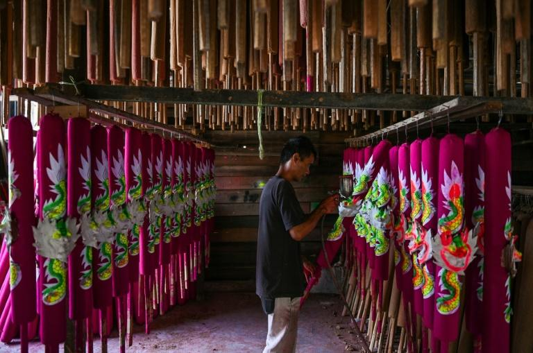 Workers spend months using a traditional method to craft the sticks -- some as tall as two metres (6.5 feet)