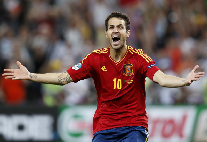 Spain's Cesc Fabregas celebrates after scoring the decisive penalty shootout during the Euro 2012 soccer championship semifinal match between Spain and Portugal in Donetsk, Ukraine, Thursday, June 28, 2012. (AP Photo/Jon Super)