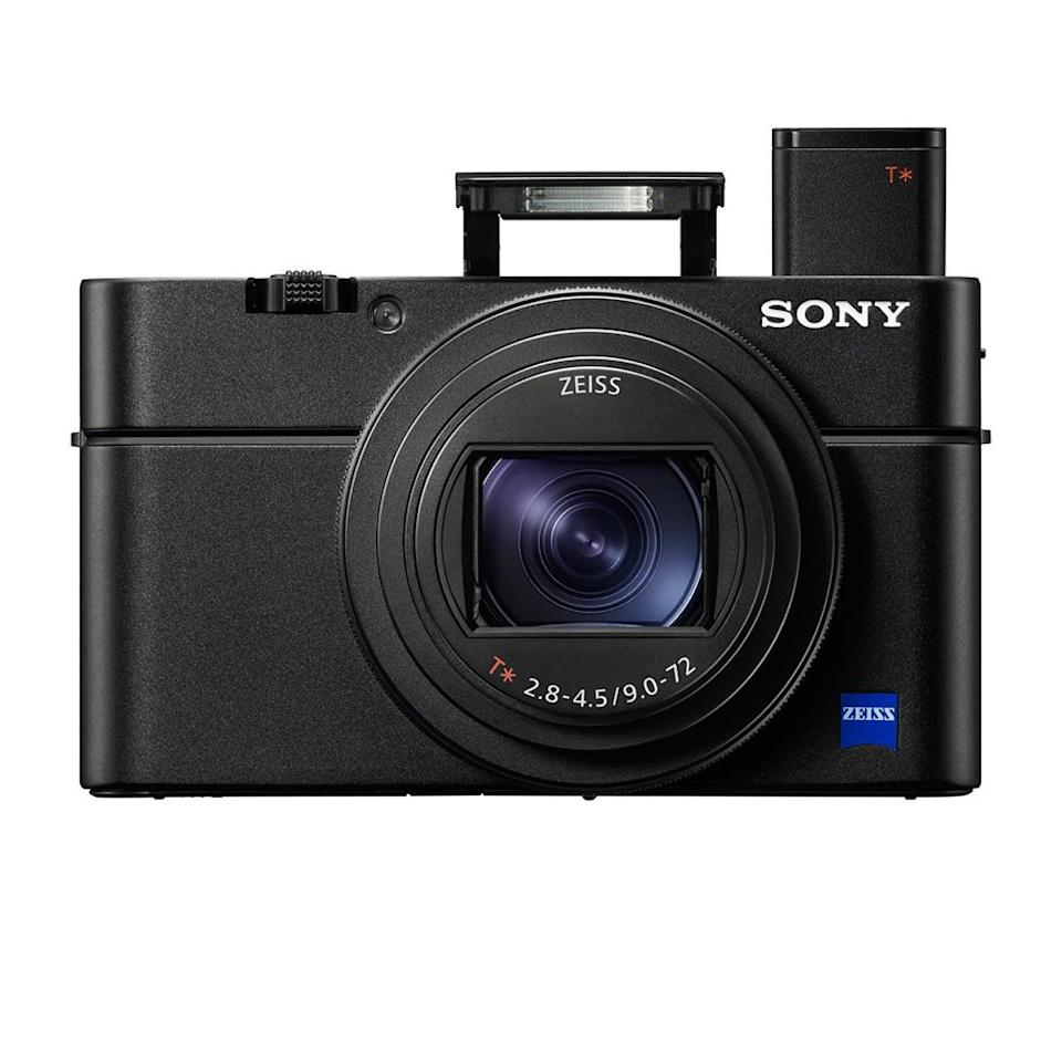 """<p><strong>Sony</strong></p><p>amazon.com</p><p><strong>$1198.00</strong></p><p><a rel=""""nofollow"""" href=""""http://www.amazon.com/dp/B07DKG29RG/"""">SHOP NOW</a></p><p>The Cyber-Shot DSC-RX100 VI by Sony is the best point-and-shoot camera money can buy, as well as a great gift for photographers who like to travel light. The ultra fast camera fits in a jacket pocket, yet it can shoot 4K video and capture images whose quality rivals that of a pro-grade DSLR on more than one occasion, thanks to its 1-inch sensor. </p><p>The DSC-RX100 VI is also beautifully crafted and easy to use. Despite its compact size, the camera has an impressive zoom range that's more versatile than any past RX100 iterations. </p><p><strong>More: </strong><a rel=""""nofollow"""" href=""""https://www.bestproducts.com/tech/gadgets/g293/best-tech-gifts-at-every-price/"""">Gift Ideas Within the Whole Tech Spectrum</a></p>"""