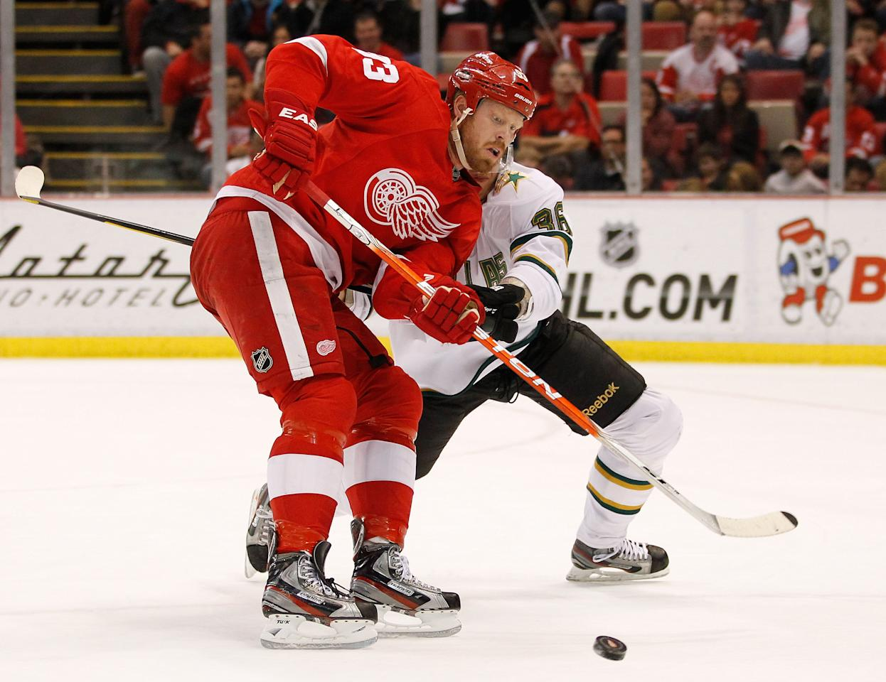 DETROIT, MI - FEBRUARY 14: Johan Franzen #93 of the Detroit Red Wings tries to control the puck in front of Philip Larsen #36 of the Dallas Stars at Joe Louis Arena on February 14, 2012 in Detroit, Michigan. (Photo by Gregory Shamus/Getty Images)