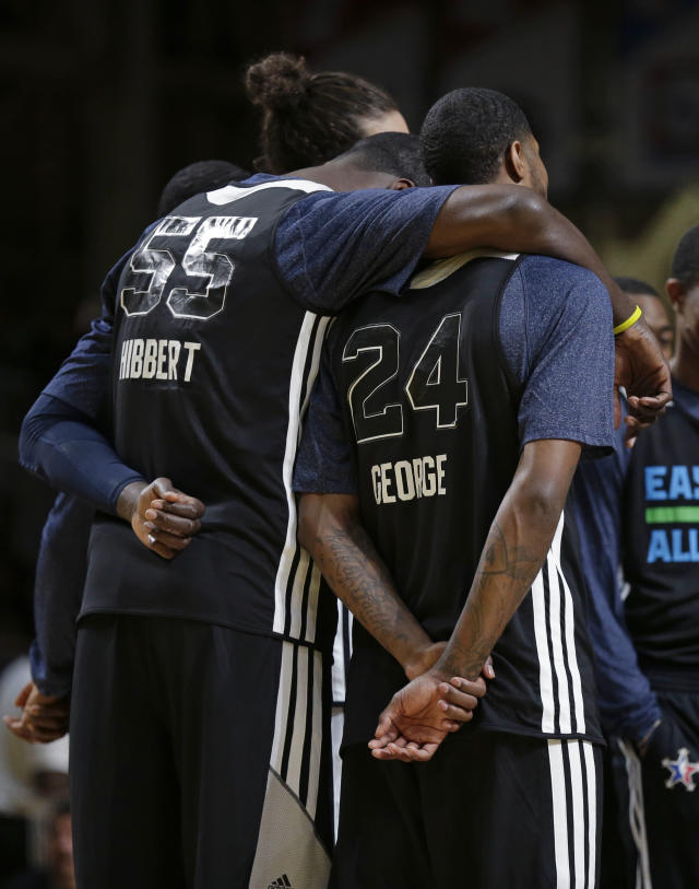 East Team's Roy Hibbert, of the Indiana Pacers, puts his arm around Paul George, of the Indiana Pacers, during NBA All-Star game basketball practice in New Orleans, Saturday, Feb. 15, 2014. (AP Photo/Gerald Herbert)