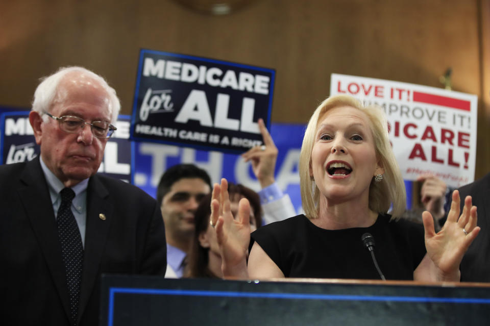 Sen. Kirsten Gillibrand, D-N.Y. with Sen. Bernie Sanders, I-Vt., speaks at a gathering introducing the Medicare for All Act of 2019, on Capitol Hill in Washington, Wednesday, April 10, 2019. (AP Photo/Manuel Balce Ceneta)