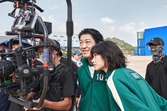 Jung Ho-yeon, right, behind the scenes during the filming of