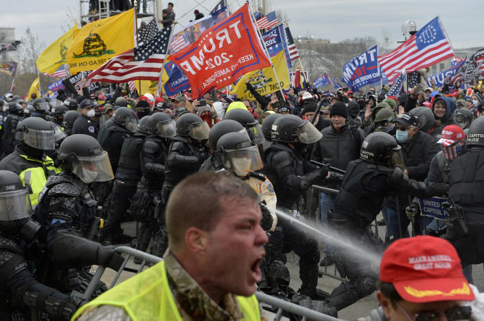 Trump supporters clash with police and security forces as people try to storm the Capital Building. (Joseph Prezioso/AFP via Getty Images)