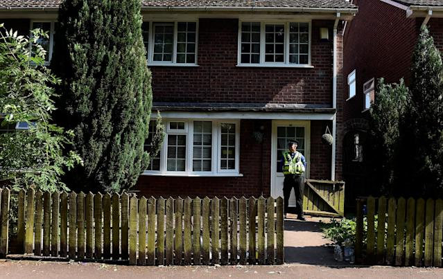 A police officer stands outside the home of Darren Osborne, in Cardiff, Wales, on June 20, 2017. He was convicted of driving a rented van into Muslim worshippers outside a London mosque. (Rebecca Naden / Reuters)