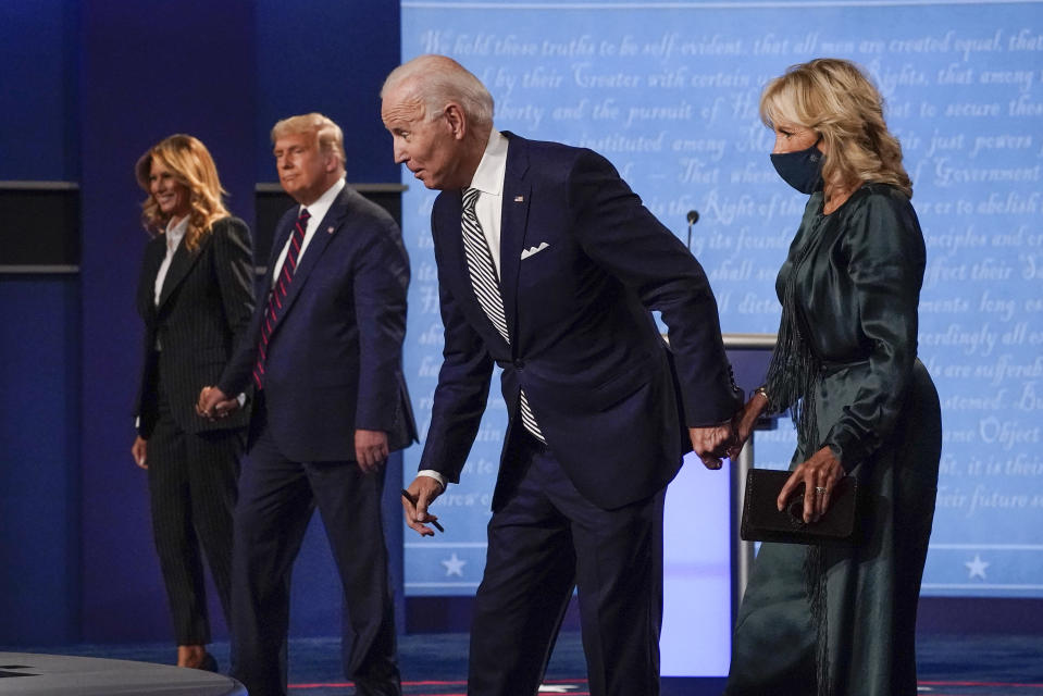 In this Sept. 29, 2020, file photo, from l-r., first lady Melania Trump, President Donald Trump, Democratic presidential candidate former Vice President Joe Biden and Jill Biden during the first presidential debate at Case Western University and Cleveland Clinic, in Cleveland, Ohio. President Trump and first lady Melania Trump have tested positive for the coronavirus, the president tweeted early Friday. (AP Photo/Julio Cortez, File)