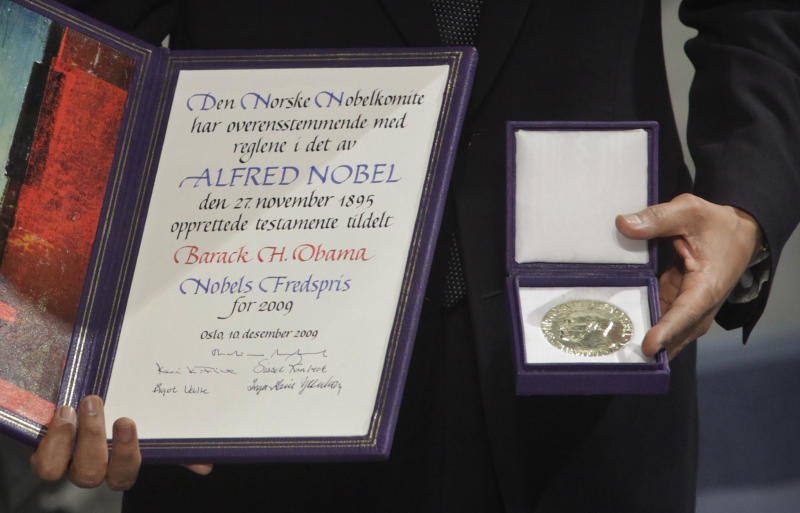 FILE - This is a Thursday, Dec. 10, 2009 file photo of U.S. President and Nobel Peace Prize laureate Barack Obama poses with  his medal and diploma at the Nobel Peace Prize ceremony at City Hall  in Oslo.  The nomination deadline for the 2012 Nobel Peace Prize closed Wednesday Feb. 1, 2012  amid renewed criticism that the award committee has drifted away from the selection criteria established by prize founder Alfred Nobel.  (AP Photo/Odd Andersen)