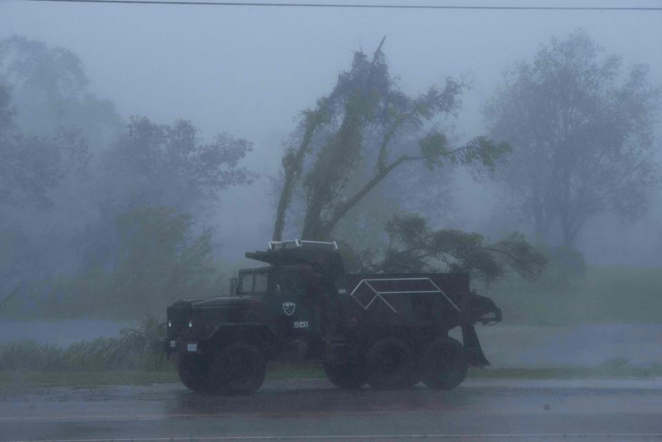 A truck is seen in heavy winds and rain from hurricane Ida in Bourg, Louisiana on August 29, 2021. - Hurricane Ida struck the coast of Louisiana Sunday as a powerful Category 4 storm, 16 years to the day after deadly Hurricane Katrina devastated the southern US city of New Orleans.