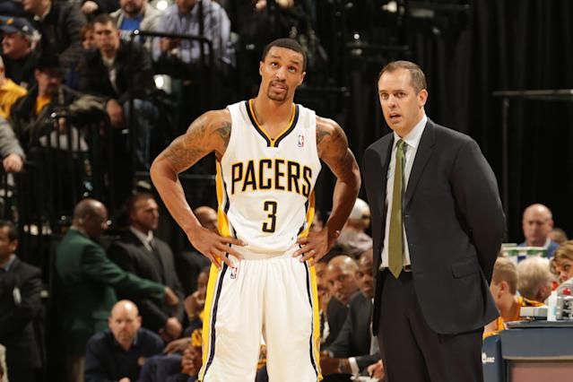 INDIANAPOLIS - JANUARY 14: Frank Vogel and George Hill #3 of the Indiana Pacers share a word during the game against the Sacramento Kings at Bankers Life Fieldhouse on January 14, 2014 in Indianapolis, Indiana. (Photo by Ron Hoskins/NBAE via Getty Images)