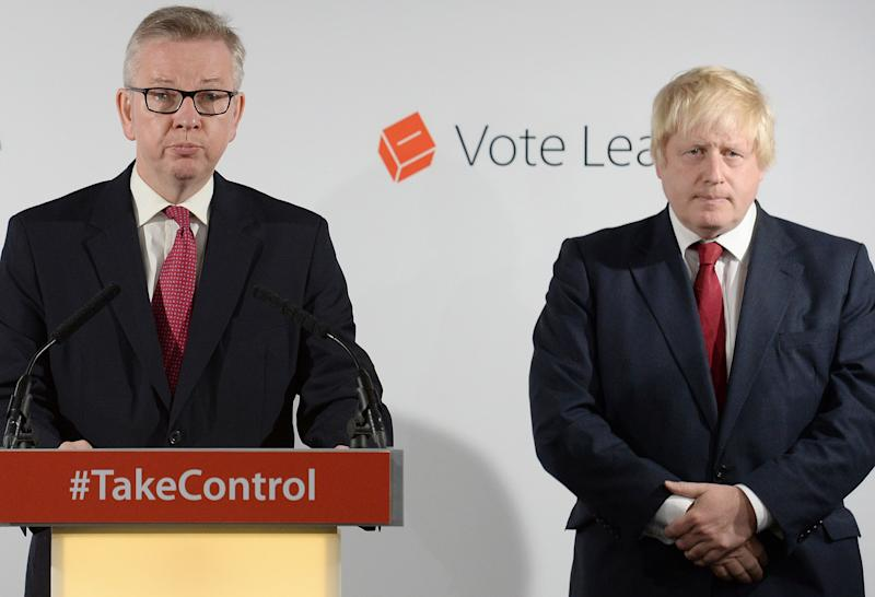 """Former London Mayor and """"Vote Leave"""" campaigner Boris Johnson (R), listens as British Lord Chancellor and Justice Secretary Michael Gove, a fellow Brexit supporter, speaks during a press conference in central London on June 24, 2016. Boris Johnson, who spearheaded the successful campaign for Britain to leave the European Union, said Friday there was no need to rush the process of pulling out of the bloc. / AFP / POOL / Stefan Rousseau (Photo credit should read STEFAN ROUSSEAU/AFP/Getty Images)"""