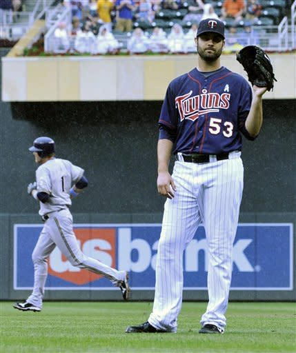 Milwauee Brewers' Corey Hart, rear, rounds the bases after his three-run home run off Minnesota Twins pitcher Nick Blackburn, right, in the fifth inning of a baseball game, Sunday, June 17, 2012, in Minneapolis. (AP Photo/Jim Mone)