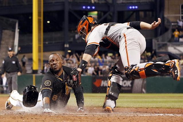 10ThingstoSeeSports - Pittsburgh Pirates' Starling Marte, left, scores ahead of the tag by San Francisco Giants catcher Buster Posey in the ninth inning of a baseball game in Pittsburgh, Tuesday, May 6, 2014. Marte was called out initially by home plate umpire Quinn Wolcott, but the call was overturned upon review. It was a walk-off triple, and an error, that allowed Marte to score. The Pirates won 2-1. (AP Photo/Gene J. Puskar, File)