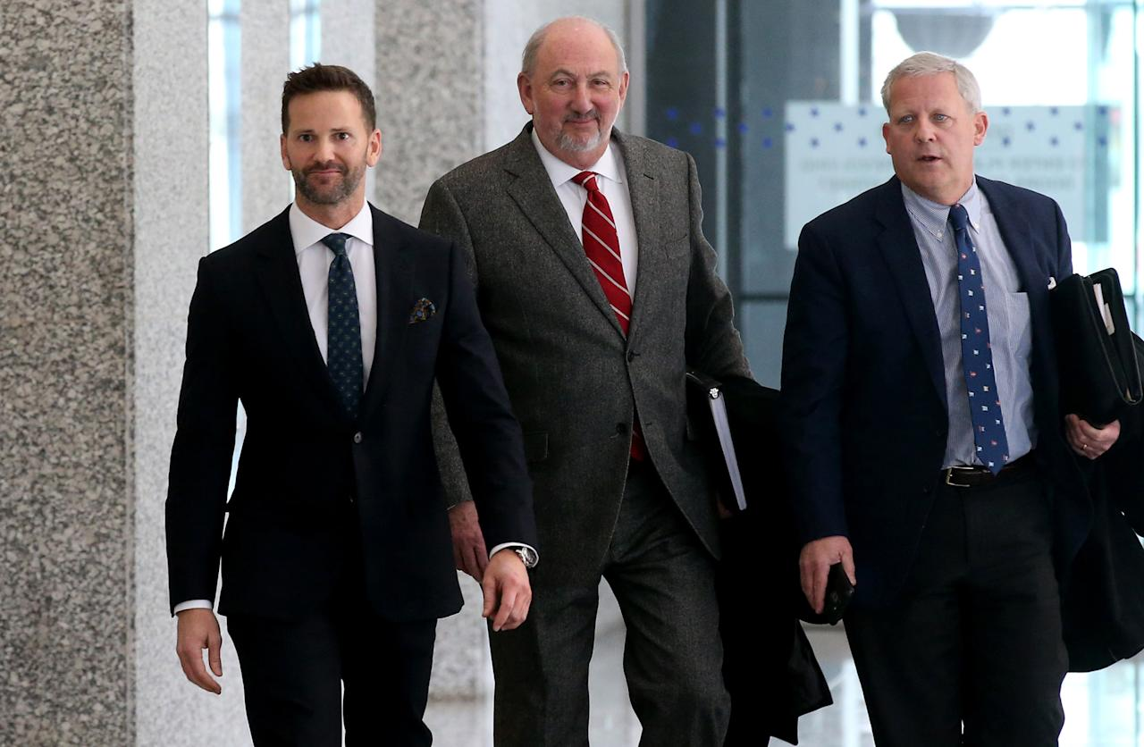 Former U.S. Rep. Aaron Schock, left, appears Wednesday, March 6, 2019 after his scheduled hearing at the U.S. Dirksen Courthouse in Chicago, Ill. Federal prosecutors have agreed to drop all charges against him if he pays back money he owes to the Internal Revenue Service and his campaign fund. (Antonio Perez/Chicago Tribune/Tribune News Service via Getty Images)