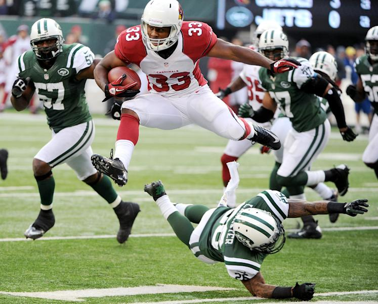 Arizona Cardinals running back William Powell (33) leaps over New York Jets defensive back Ellis Lankster during the second half of an NFL football game, Sunday, Dec. 2, 2012, in East Rutherford, N.J. (AP Photo/Bill Kostroun)