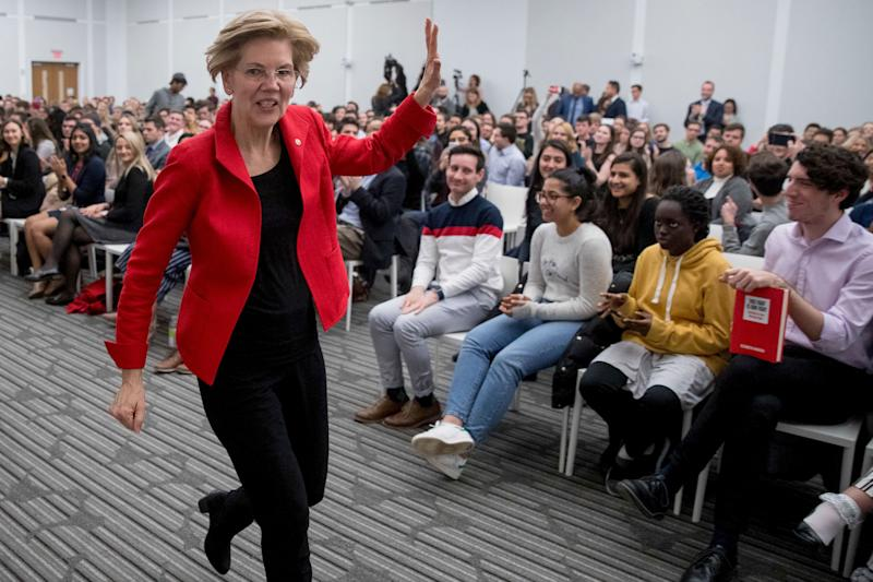 Sen. Elizabeth Warren, D-Mass., waves as she departs after speaking at the American University Washington College of Law in Washington, Thursday, Nov. 29, 2018, on her foreign policy vision for the country. (AP Photo/Andrew Harnik)