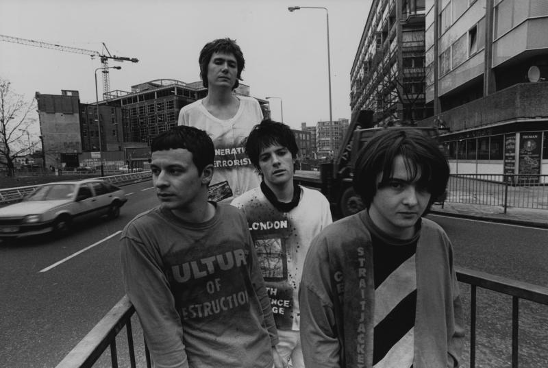 Group portrait of the Manic Street Preachers, Elephant & Castle roundabout, London, 1990. L-R James Dean Bradfield, Nicky Wire, Richey Edwards and Sean Moore. (Photo by Martyn Goodacre/Getty Images)