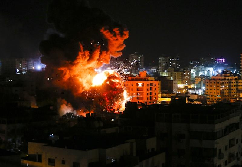 Fire and smoke billow above buildings in Gaza City March 25, 2019 as Israel's military launched strikes on Hamas targets in the Gaza Strip hours after a rocket from the Palestinian enclave hit a house and wounded seven Israelis