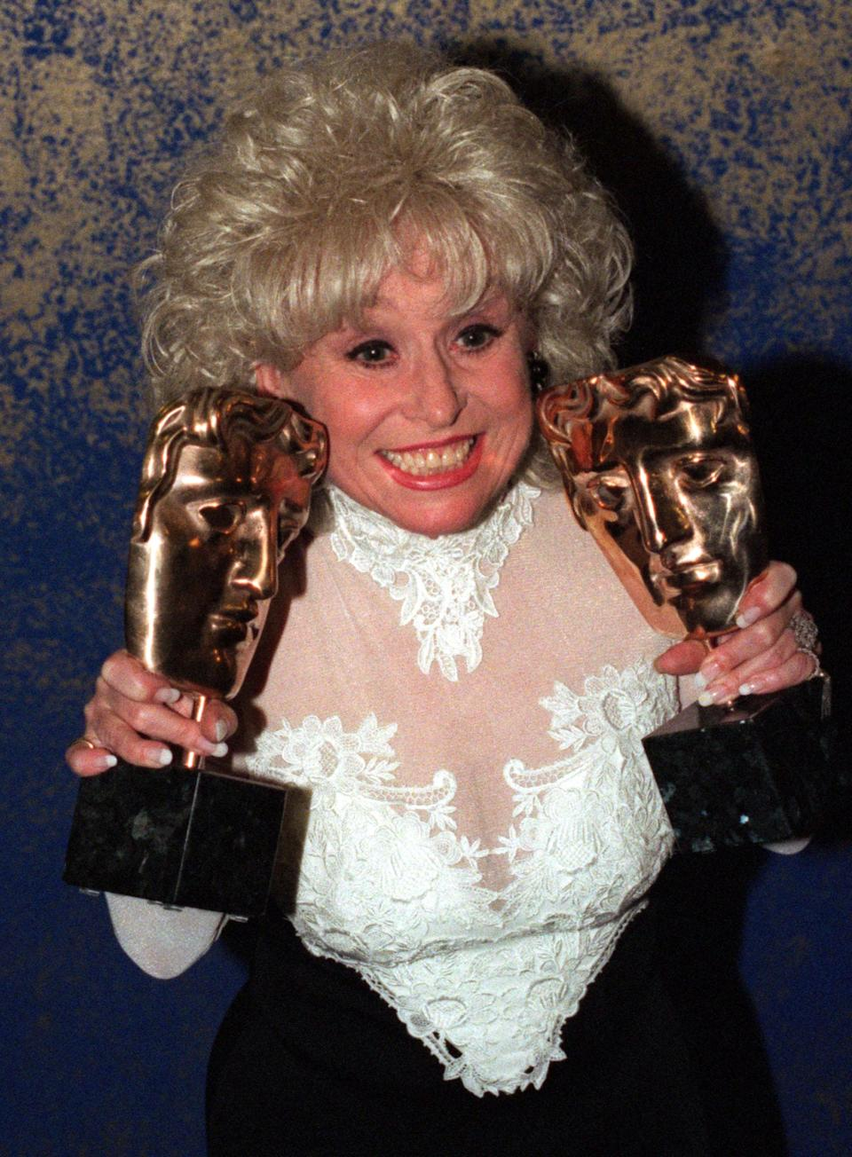 Eastenders actress Barbara Windsor holds two BAFTA awards during the ceremony held at London's Royal Albert Hall April 29. Windsor, who presented one award, received the other for Eastenders as the hit soap won the Best Drama Series Award.