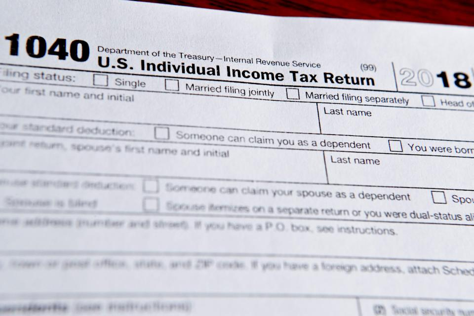 This photo made on Wednesday, Feb. 13, 2019, in Zelienople, Pa., shows 1040 tax forms printed from the Internal Revenue Service web page that are used for 2018 U.S. federal tax returns. (AP Photo/Keith Srakocic)