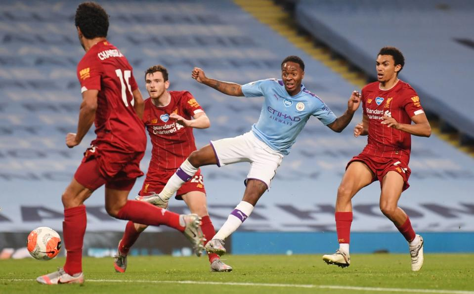 Manchester City's Raheem Sterling scores against Liverpool in their Premier League encounter last season.