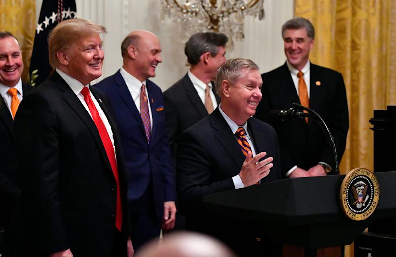 President Donald Trump looks on as Senator Lindsey Graham speaks at a January ceremony honoring the college football champion Clemson Tigers at the White House.