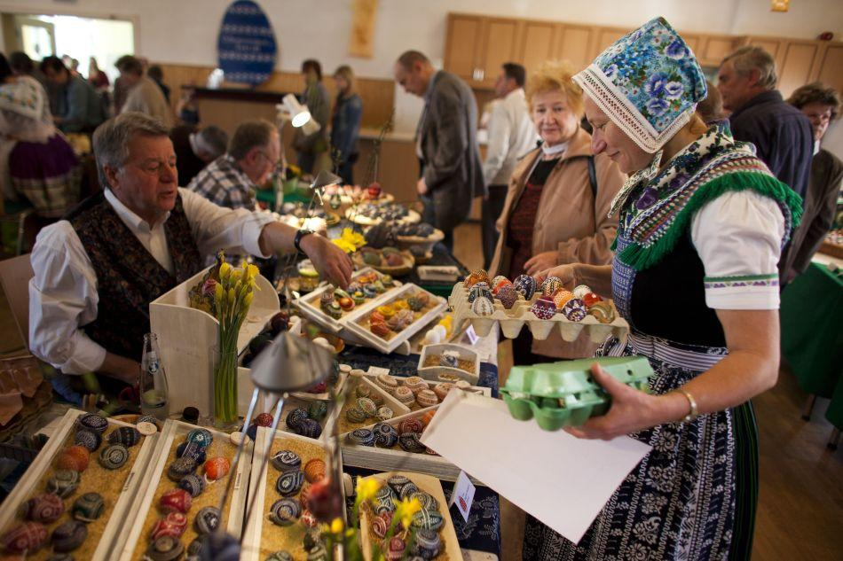 Sylvia Panoscha (R), wearing a traditional Lusatian sorbian folk dress, arranges eggs at the annual traditional Sorbian Easter egg market in Schleife, near Hoyerswerda, Germany. Easter egg painting is a strong part of Sorbian tradition and visual elements within the painting are meant to ward off evil. Sorbians are a Slavic minority in eastern Germany and many still speak Sorbian, a language closely related to Polish and Czech.