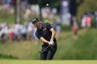 Patrick Cantlay chips onto the fourth green during the third round of the BMW Championship golf tournament, Saturday, Aug. 28, 2021, at Caves Valley Golf Club in Owings Mills, Md. (AP Photo/Julio Cortez)