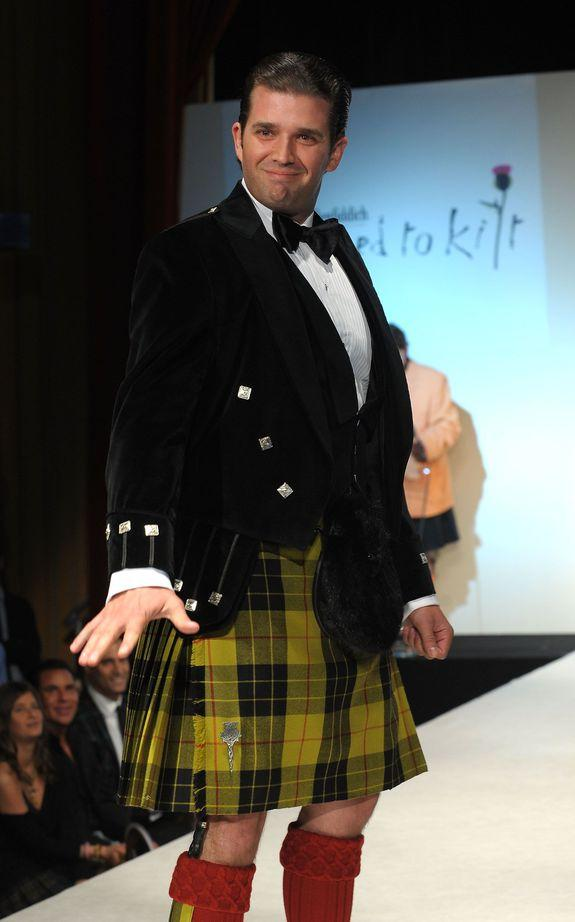 """NEW YORK - APRIL 05: Donald Trump Jr. walks the runway at the 8th annual """"Dressed To Kilt"""" Charity Fashion Show presented by Glenfiddich at M2 Ultra Lounge on April 5, 2010 in New York City. (Photo by Andrew H. Walker/Getty Images)"""