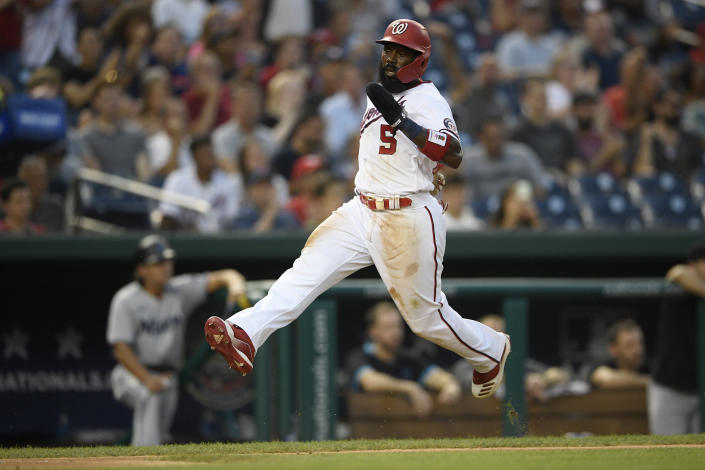 Washington Nationals' Josh Harrison high-steps toward home to score on a double by Andrew Stevenson during the fourth inning of the team's baseball game against the Miami Marlins, Wednesday, July 21, 2021, in Washington. (AP Photo/Nick Wass)