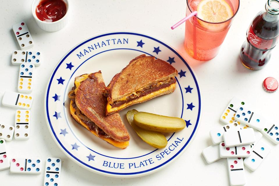 """This classic diner mash-up of a grilled cheese sandwich and a hamburger is stuffed with thick, sweet rings of pan-seared onion. <a href=""""https://www.epicurious.com/recipes/food/views/diner-style-patty-melt?mbid=synd_yahoo_rss"""" rel=""""nofollow noopener"""" target=""""_blank"""" data-ylk=""""slk:See recipe."""" class=""""link rapid-noclick-resp"""">See recipe.</a>"""