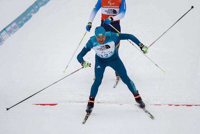 Vitaliy Luk'Yanenko of Ukraine and his guide Ivan Marchyshak cross the finish line in the Biathlon Visually Impaired Men's 15km at the Alpensia Biathlon Centre. The Paralympic Winter Games, PyeongChang, South Korea, Friday 16th March 2018. OIS/IOC/Simon Bruty/Handout via Reuters