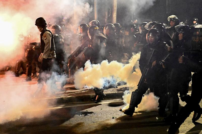 Police in Jakarta clashed with some anti-Widodo protesters who had refused to leave after the end of an otherwise peaceful demonstration (AFP Photo/BAY ISMOYO)