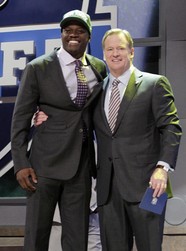 Georgia Tech wide reciever Stephen HIll, left, poses for photographs with NFL Commissioner Roger Goodell after being selected 43rd overall by the New York Jets in the second round of the NFL football draft by the at Radio City Music Hall Friday, April 27, 2012 in New York. (AP Photo/Frank Franklin II)