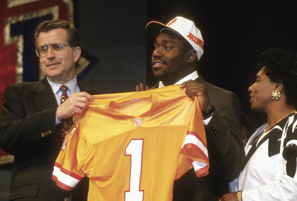 Warren Sapp, standing with late NFL commissioner Paul Tagliabue, wasn't thrilled when the Bucs made him the 12th overall pick in the 1995 NFL draft. (Photo by Focus on Sport/Getty Images)