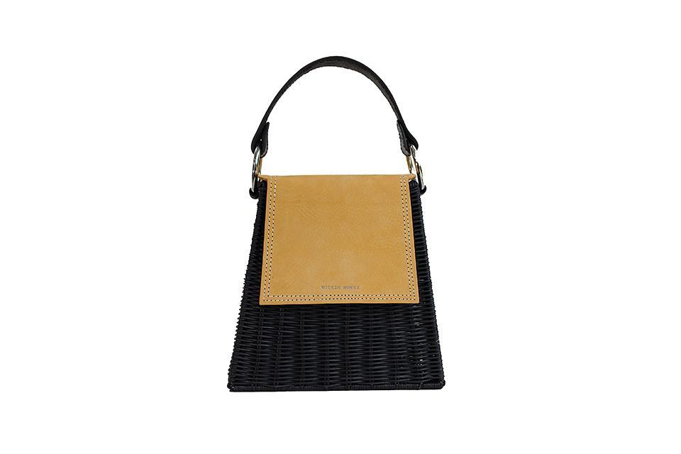 """<p>Who said fashion couldn't be guilt-free? This Christmas, Wicker Wings is the brand at the top of our wish list all down to this seriously lust-worthy bag. <em><a href=""""https://wickerwings.com/store/Mustard-Tall-T%C4%ABx%C3%ADng-p88570246"""" rel=""""nofollow noopener"""" target=""""_blank"""" data-ylk=""""slk:Wicker Wings"""" class=""""link rapid-noclick-resp"""">Wicker Wings</a>, £280</em> </p>"""
