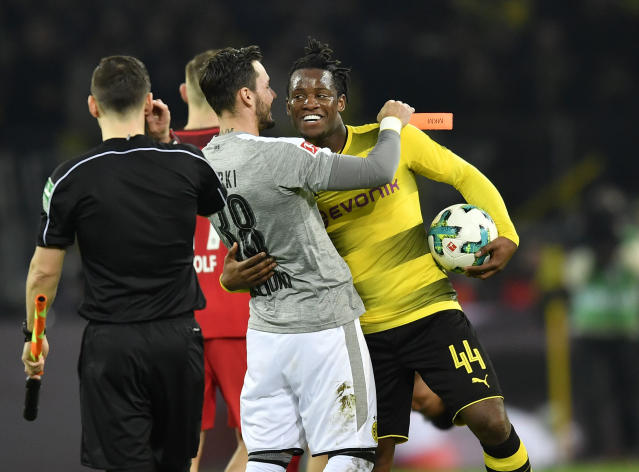 Dortmund's match winner Michy Batshuayi is celebrated by Dortmund goalkeeper Roman Buerki after the German Bundesliga soccer match between Borussia Dortmund and Eintracht Frankfurt in Dortmund, Germany, Sunday, March 11, 2018. Dortmund defeated Frankfurt in a dramatic 3-2. (AP Photo/Martin Meissner)
