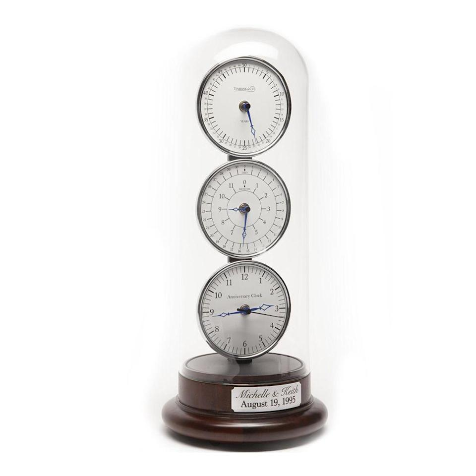 """<p><strong>TheAnniversaryClock</strong></p><p>etsy.com</p><p><strong>$349.00</strong></p><p><a href=""""https://go.redirectingat.com?id=74968X1596630&url=https%3A%2F%2Fwww.etsy.com%2Flisting%2F692444346%2Fthe-anniversary-clock-musical-wedding&sref=https%3A%2F%2Fwww.bestproducts.com%2Flifestyle%2Fg33823101%2F25th-wedding-anniversary-gifts%2F"""" rel=""""nofollow noopener"""" target=""""_blank"""" data-ylk=""""slk:Shop Now"""" class=""""link rapid-noclick-resp"""">Shop Now</a></p><p>This custom clock is no ordinary time-teller. Three individual clock faces display the years, months, days, hours, minutes and seconds from when you got married, and <a href=""""https://www.bestproducts.com/lifestyle/g32407458/10-year-anniversary-gifts/"""" rel=""""nofollow noopener"""" target=""""_blank"""" data-ylk=""""slk:on your actual anniversary"""" class=""""link rapid-noclick-resp"""">on your actual anniversary</a>, it'll automatically play your wedding song.</p>"""