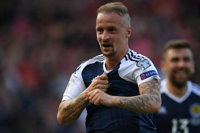 Scotland international Leigh Griffiths was targeted by objects thrown from a section of the home crowd while taking a corner against Belfast side Linfield (AFP Photo/Paul ELLIS)