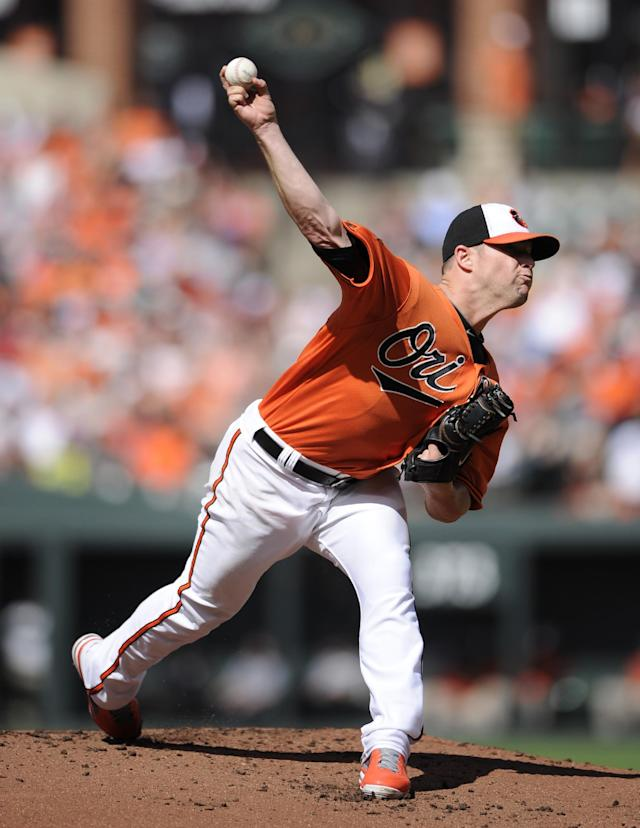 Baltimore Orioles starting pitcher Bud Norris throws to a Toronto Blue Jays batter during the first inning of a baseball game, Saturday, June 14, 2014, in Baltimore. (AP Photo/Nick Wass)