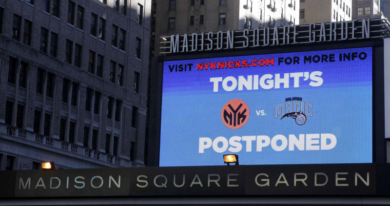 A billboard in front of Madison Square Garden displays a notice regarding tonight's basketball game in New York, Tuesday, Nov. 2, 2010. The Orlando Magic-New York Knicks game  was postponed Tuesday because of safety concerns after debris fell into the arena during overnight cleaning of asbestos-related materials. (AP Photo/Seth Wenig)