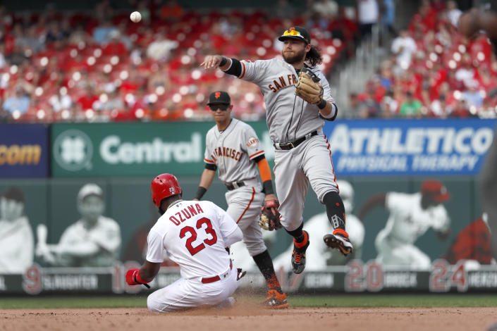 St. Louis Cardinals' Marcell Ozuna (23) is out at second but San Francisco Giants shortstop Brandon Crawford, right, is unable to turn the double play while Giants second baseman Mauricio Dubon watches during the eighth inning of a baseball game Monday, Sept. 2, 2019, in St. Louis. Cardinals' Paul DeJong was safe at first. (AP Photo/Jeff Roberson)
