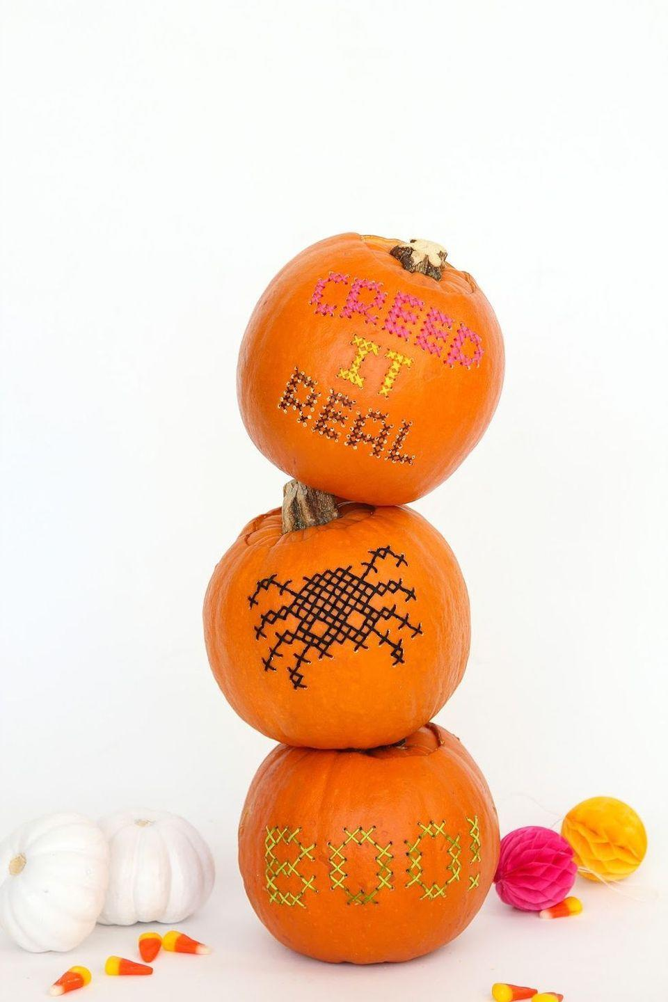 """<p>Crafters, you're going to love this one: With a little bit of embroidery thread and the help of a drill bit, these DIY pumpkins really do end up looking like cross-stitched masterpieces. </p><p><strong>Get the tutorial at <a href=""""http://www.awwsam.com/2015/10/diy-cross-stitch-pumpkins-on.html"""" rel=""""nofollow noopener"""" target=""""_blank"""" data-ylk=""""slk:Aww Sam"""" class=""""link rapid-noclick-resp"""">Aww Sam</a>.</strong></p><p><strong><a class=""""link rapid-noclick-resp"""" href=""""https://go.redirectingat.com?id=74968X1596630&url=https%3A%2F%2Fwww.walmart.com%2Fsearch%2F%3Fquery%3Dembroidery%2Bthread&sref=https%3A%2F%2Fwww.thepioneerwoman.com%2Fhome-lifestyle%2Fcrafts-diy%2Fg36982763%2Fpumpkin-carving-ideas%2F"""" rel=""""nofollow noopener"""" target=""""_blank"""" data-ylk=""""slk:SHOP EMBROIDERY THREAD"""">SHOP EMBROIDERY THREAD</a><br></strong></p>"""