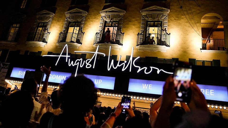 """Antoinette Chinonye Nwandu above the August Wilson marquee lit with the words """"Sun comin up we free"""" - Credit: Courtesy of Lexie Moreland"""