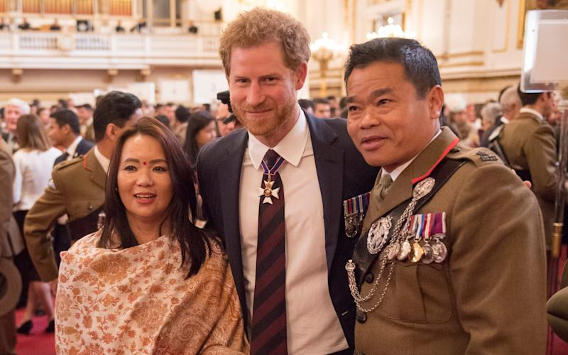 Major Chancre Bahadur Pun and his wife pose for a new photo with Prince Harry - Credit: Arthur Edwards